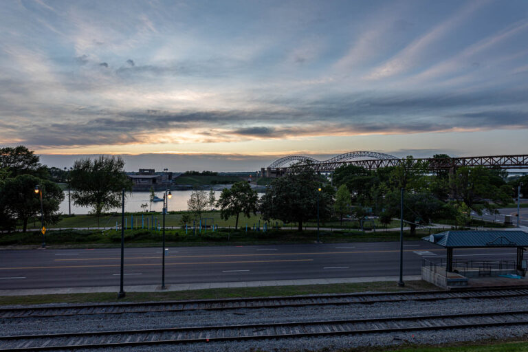 The sun sets over Memphis Park and the Mississippi River