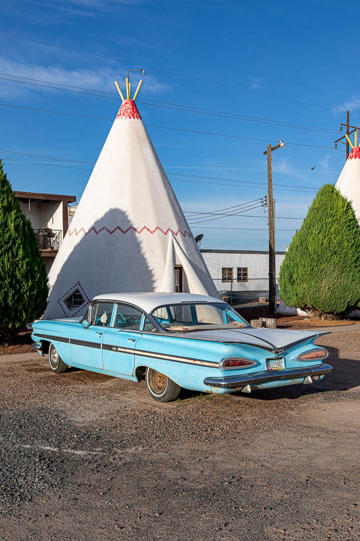 Holbrook, Arizona - A classic Chevy Impala parked in front of a tepee motel room at the Wigwam Motel